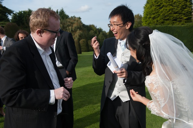 Wedding magician amazes guests at their reception