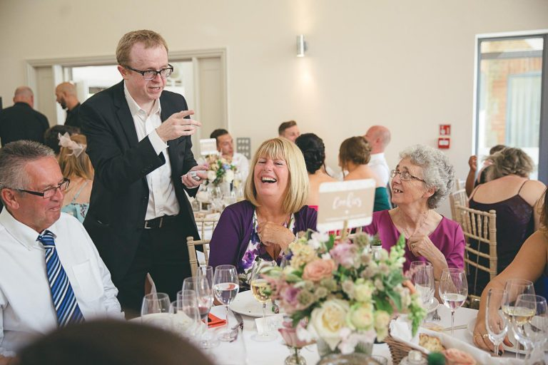 Table magician entertaining guests at a wedding