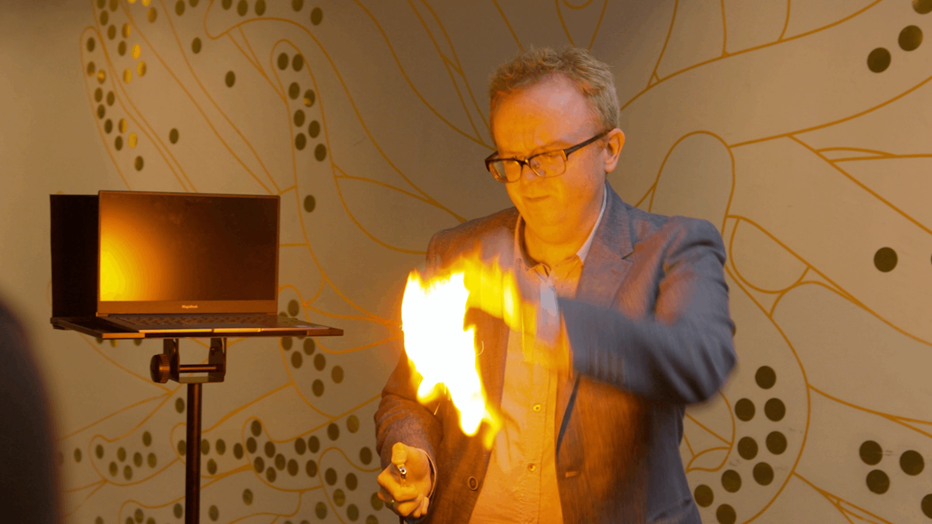 Tech magician with fire