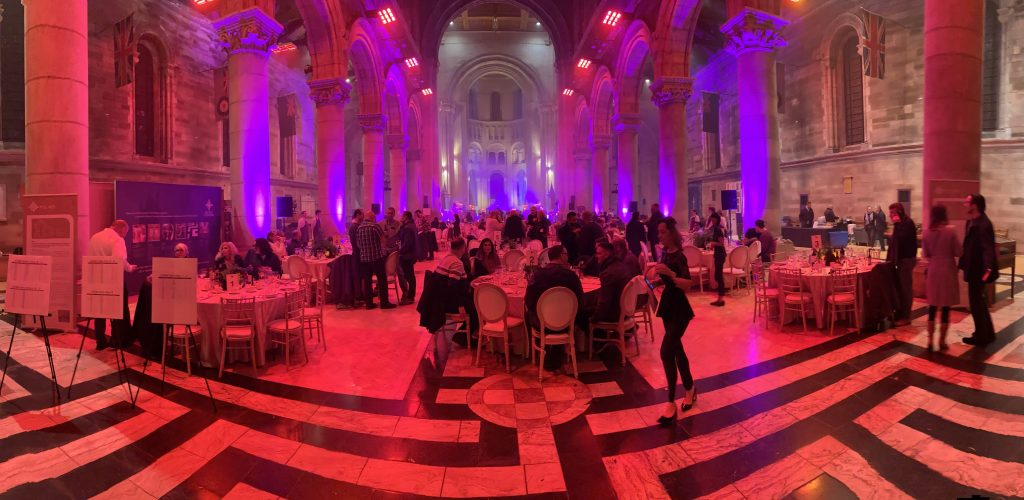 Digital Magician Noel Qualter performing at a large event in Belfast Cathedral